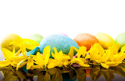 Easter egg and laburnum. Easter egg and yellow laburnum on black reflex background stock photos