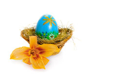Easter egg. With lily isolated on white background Royalty Free Stock Photography