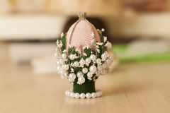 Easter egg. With lily of the valley of beads Royalty Free Stock Image
