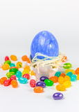 Easter egg in little nest decorated with jelly belly. Blue easter egg in little nest decorated with jelly belly Stock Photography