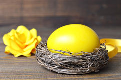 Easter egg in the nest and paper rose Stock Photo