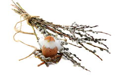 Easter egg in the nest with twigs of willow. Royalty Free Stock Photography