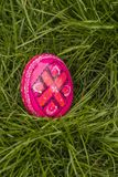 Easter Egg. One Pink Easter Egg in the grass royalty free stock image