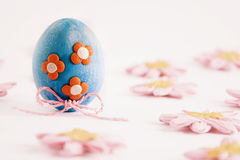 Easter egg with orange flower. Easter egg decorated with flowers on a white background Royalty Free Stock Image