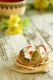easter egg with ornament on wooden royalty free stock photography