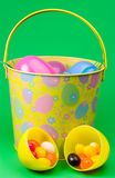 Easter egg pail. Jellybean filled Easter eggs in a pail stock photos