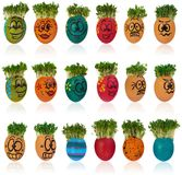 Easter egg painted in a funny smiley girl face and colorful patt. Erns with cress like hair. The watercress stylized for the hairstyle of the character. Egg in Royalty Free Stock Images