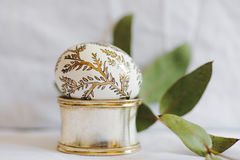 Easter egg, painted with golden branches Stock Photography
