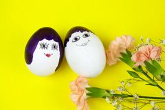 Easter egg painted in man and woman. Funny cute faces royalty free stock image