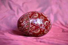 Easter egg. Painted Easter egg on pink fabric background Stock Photos