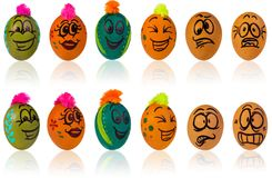 Easter egg, painted in smiling cartoon face of guy. Decorated eg. Easter eggs, hand-painted with smiling and terrified cartoon faces. Decorated eggs with funny Stock Photos
