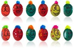 Easter egg, painted in smiling cartoon face of guy. Decorated eg. Easter eggs, hand-painted with smiling and terrified cartoon faces. Decorated eggs with funny Stock Photo