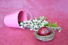 Easter egg painted with wax and spring flowers Royalty Free Stock Photography