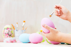 Easter egg painting in an atelier. Royalty Free Stock Images