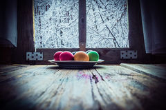 Easter egg painting winter landscape outside window Stock Photos