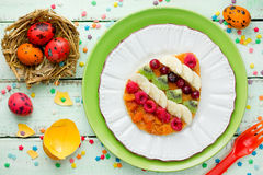Easter egg pancakes with fruit and berry for Easter breakfast Royalty Free Stock Photo