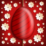 Easter egg and paper flowers on red background Stock Photography
