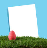 Easter egg and paper frame Stock Photography