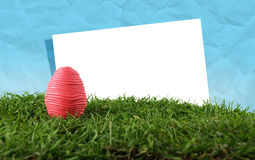 Easter egg and paper frame Stock Photos