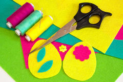 Easter egg patterns set, flower buttons, colored threads set, scissors, flat felt pieces. How to make Easter egg ornament. Step Royalty Free Stock Photography