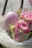 Easter egg in pink with roses in country style Stock Image