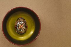 Easter egg on a plate painted in black with a handmade pattern. royalty free stock photos