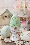 Easter egg in porcelain egg cup with rose pattern Stock Image