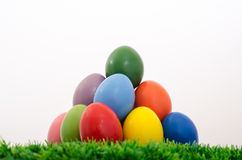 Easter egg pyramide. Colored easter egg pyramide on green grasss and white background Stock Photography
