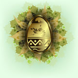 Easter egg with rabbit. Bright green design with a gold Easter egg with a silhouette of the rabbit, leaves and patterns Royalty Free Stock Photography