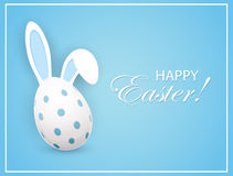 Easter egg with rabbit ears on blue background Royalty Free Stock Photos