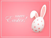 Easter egg with rabbit ears on pink background Royalty Free Stock Photo
