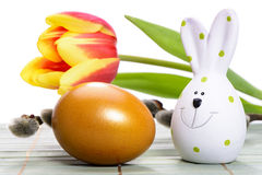Easter egg and rabbit. With tulip flower in nest Royalty Free Stock Image