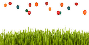 Easter egg rain over green grass Royalty Free Stock Images