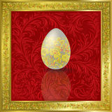 Easter egg on red Royalty Free Stock Photography
