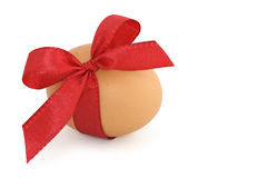 Easter egg and red bow Stock Photos