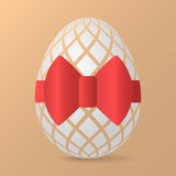 Easter egg with red ribbon Royalty Free Stock Photography