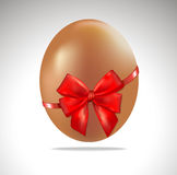 Easter egg with red ribbon. Stock Image