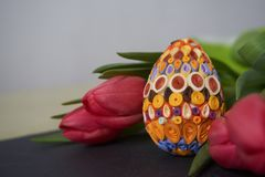 Easter egg and red tulips royalty free stock images