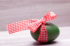 Easter egg with red white ribbo Stock Photo