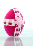Easter egg with reflection. Colorful wax Easter egg with reflection on white background Stock Images