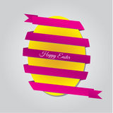 Easter egg with ribbon. Yellow Easter egg with purple ribbon Stock Image