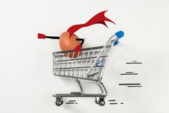 Easter egg is riding in the shopping trolley. And acting like a super hero Royalty Free Stock Image