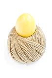 Easter egg and rolling ball of hemp rope isolated on white Royalty Free Stock Images