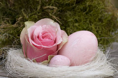 Easter egg with rose and candy Royalty Free Stock Image