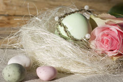 Easter egg with rose in the nest Stock Photos
