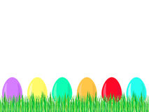 Easter egg row in grass. A row of colored Easter eggs in grass Royalty Free Stock Images