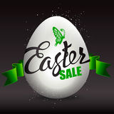 Easter egg sale with the holiday signs on a black background. Royalty Free Stock Photo