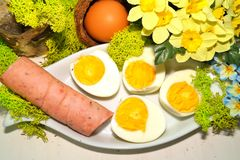Easter - egg and sausage in white dishware for easter Royalty Free Stock Images