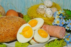 Easter - egg and sausage in white dishware for easter Stock Photography