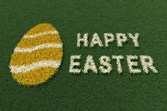 Easter egg shape and Happy Easter expression, with flowers. Easter egg shape and Happy Easter expression, with spring flowers on a green meadow Stock Photos